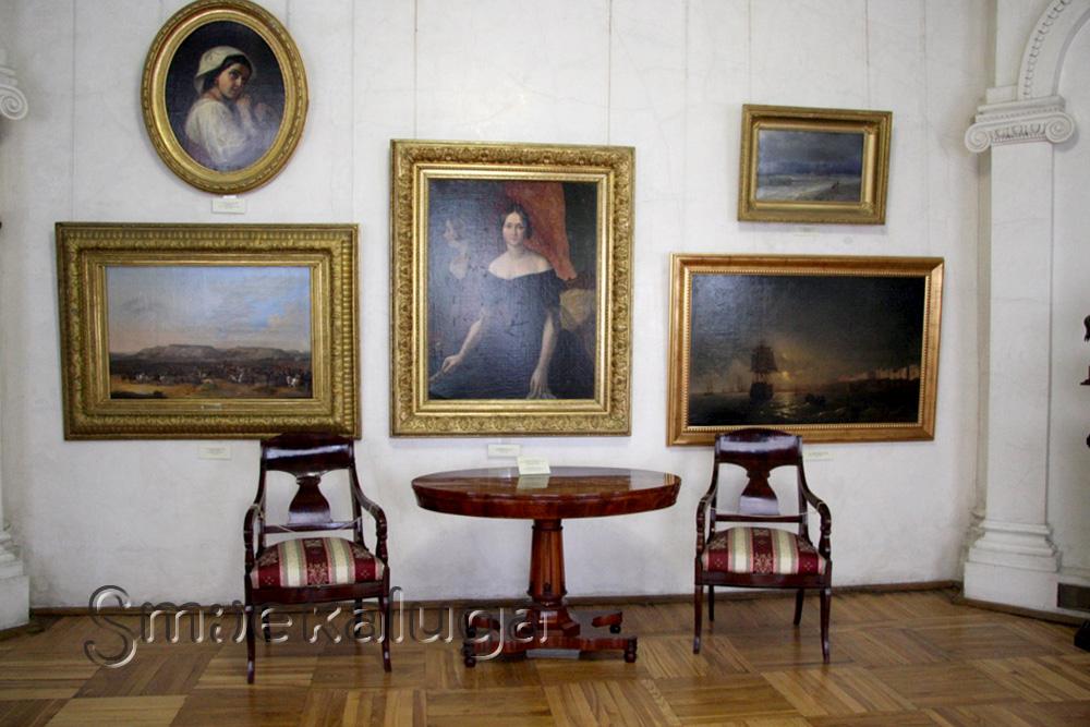 Почему на «Женском портрете» А. Мокрицкого стоит подпись двух авторов?